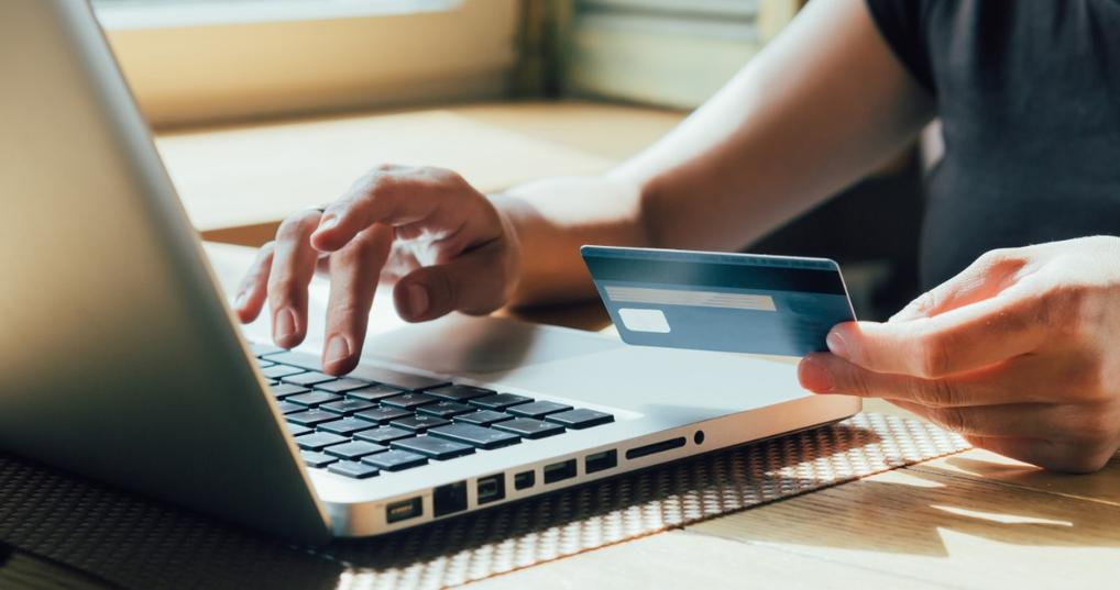 Woman paying online using credit card
