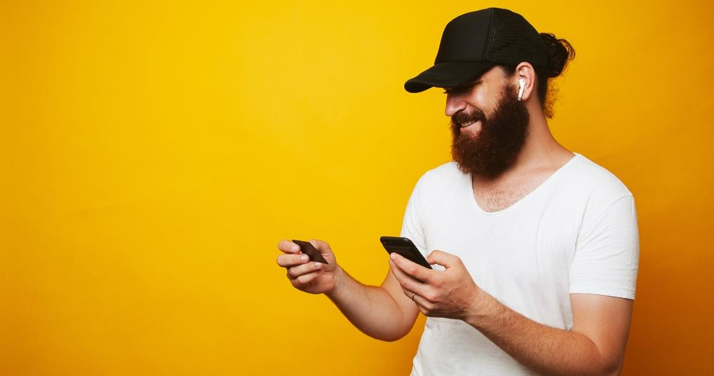 Man checking out benefits of his new credit card using smartphone
