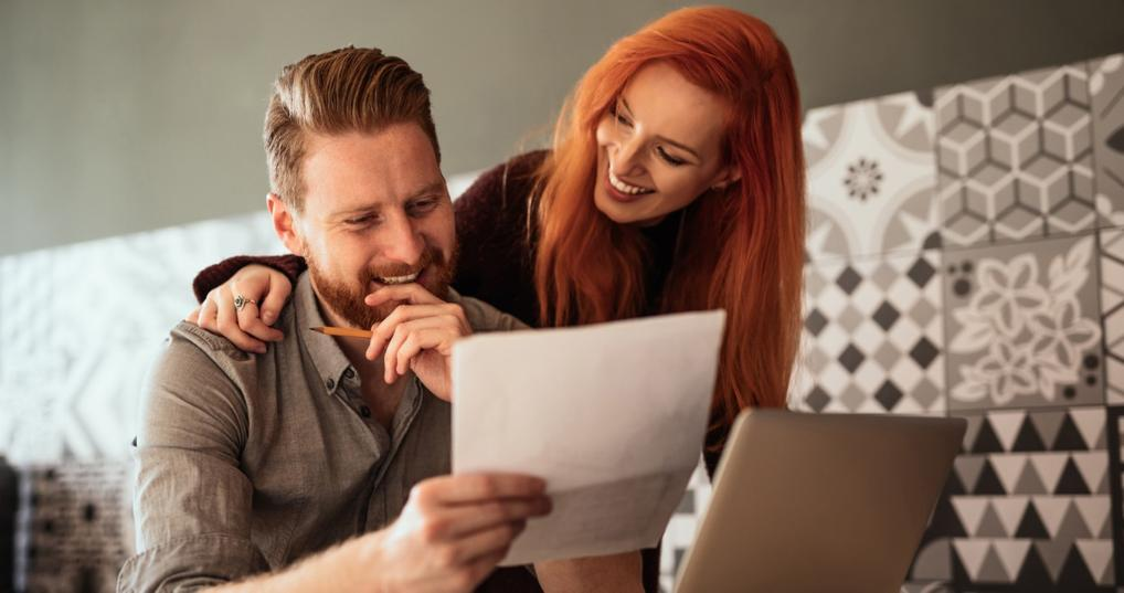 couple learning how to add authorized user on credit card