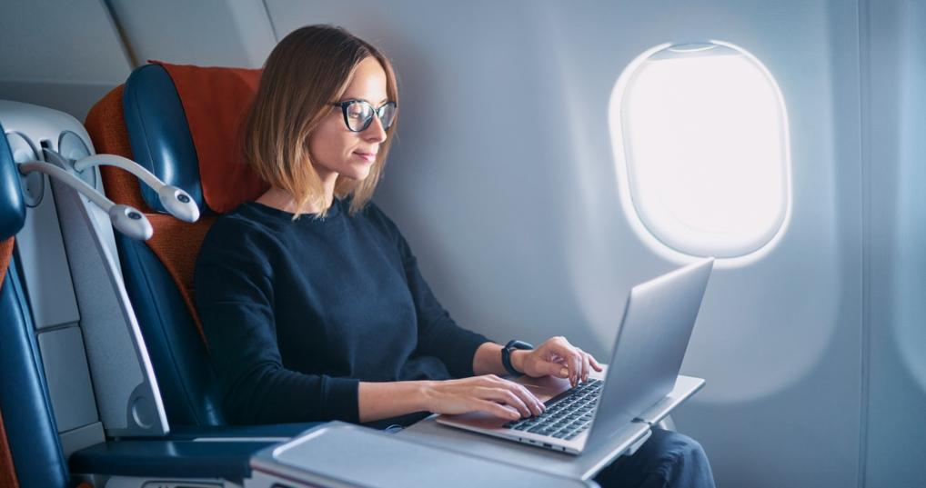 Young woman flying in a premium seat