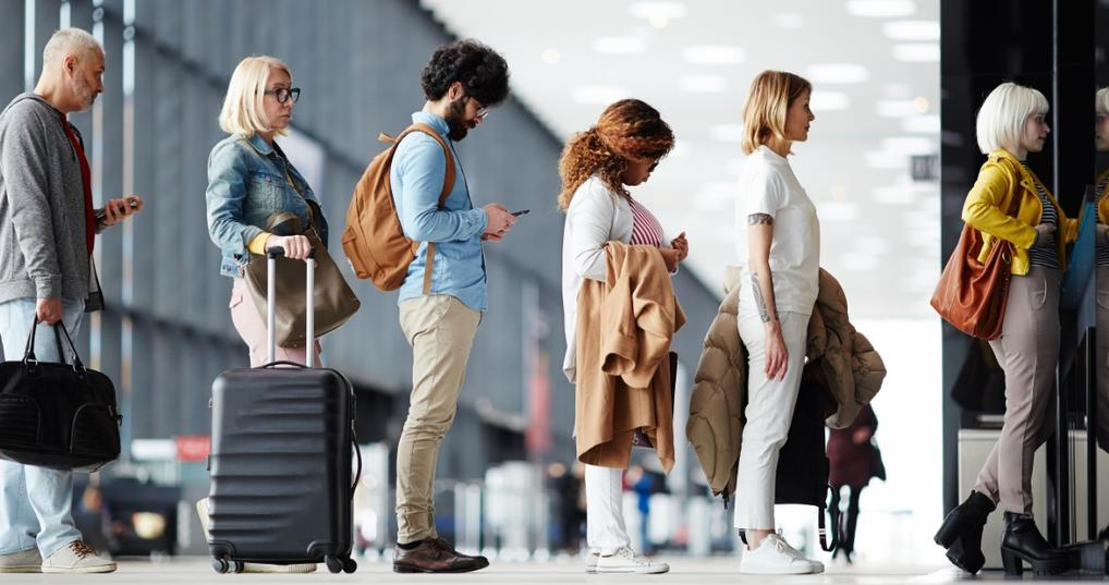 People standing in line for airport security