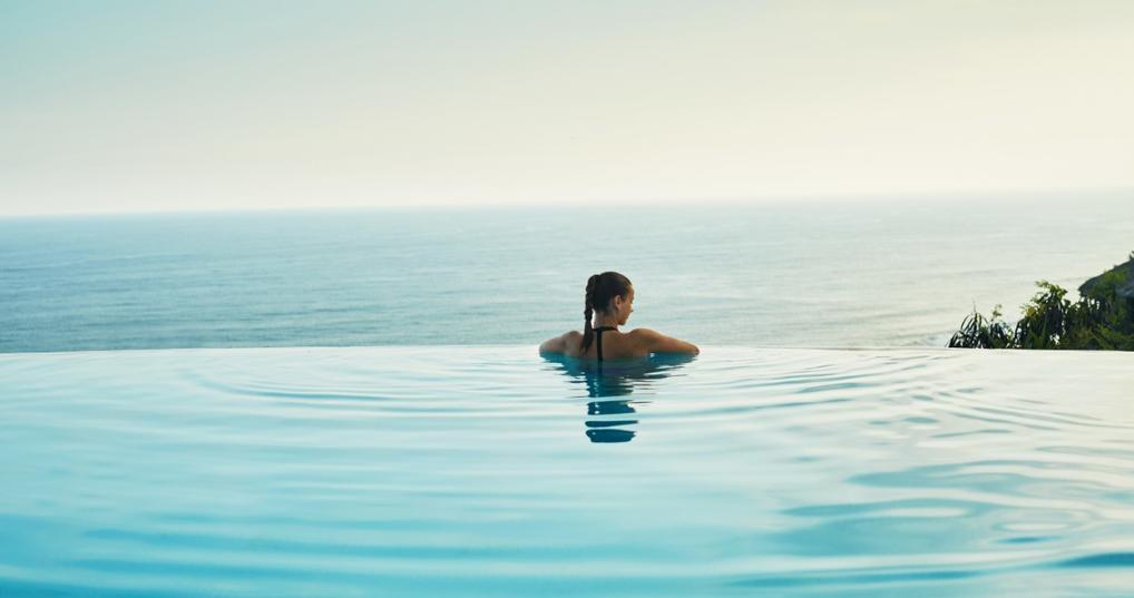 Woman enjoying the pool at a luxury resort