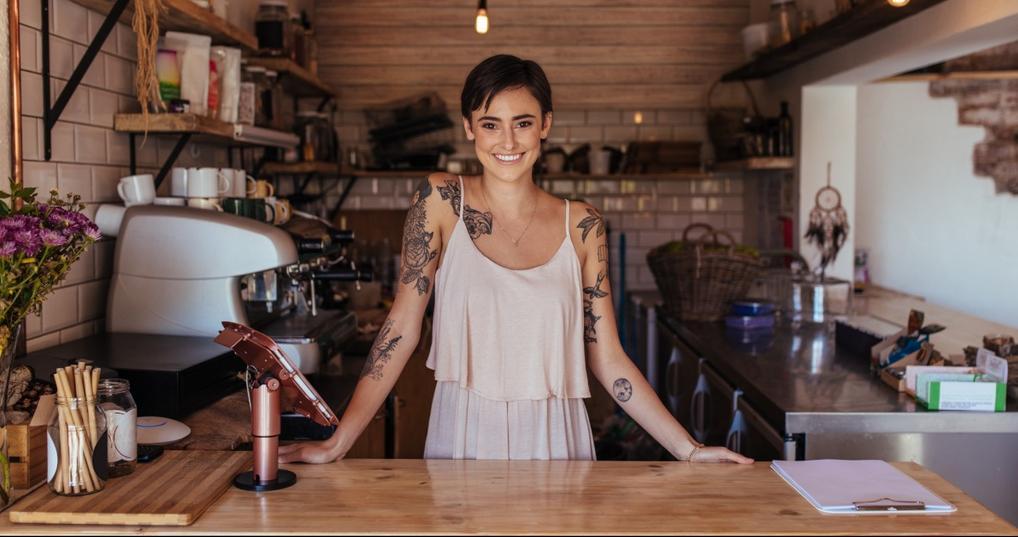Cafe owner running her shop