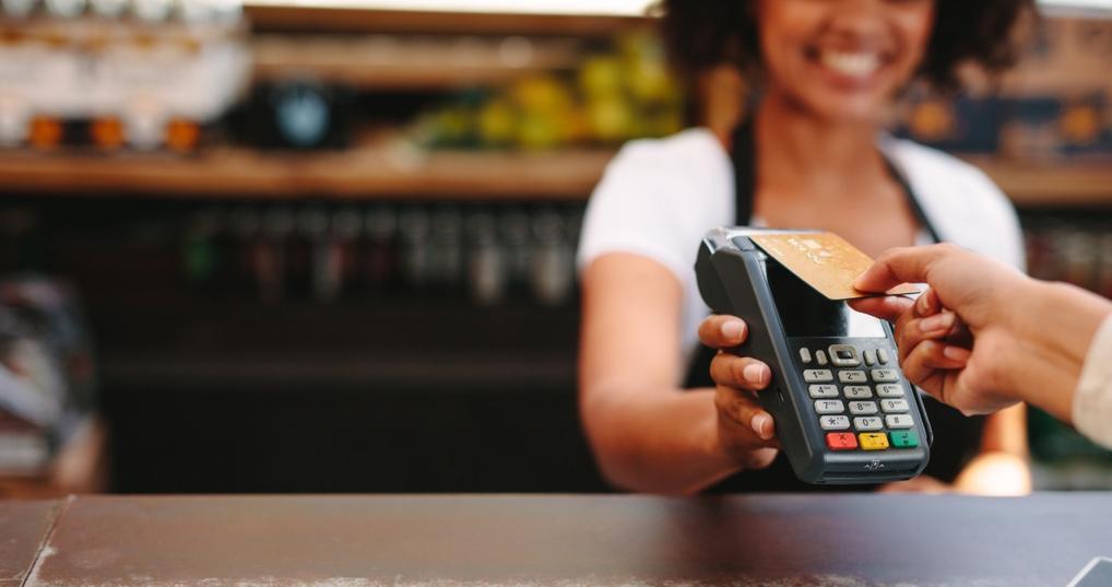 Woman paying using metal credit card