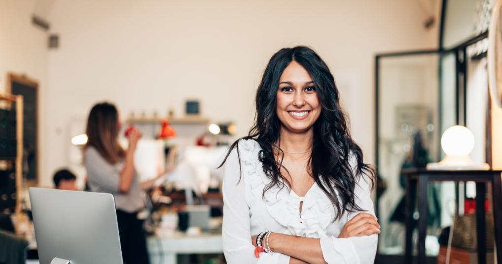 Female entrepreneur smiling in her office
