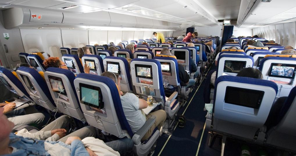Passengers sitting in airplane seats