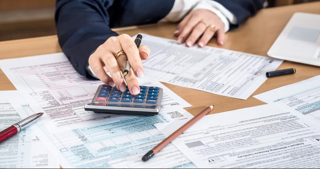 Woman calculating her tax debt