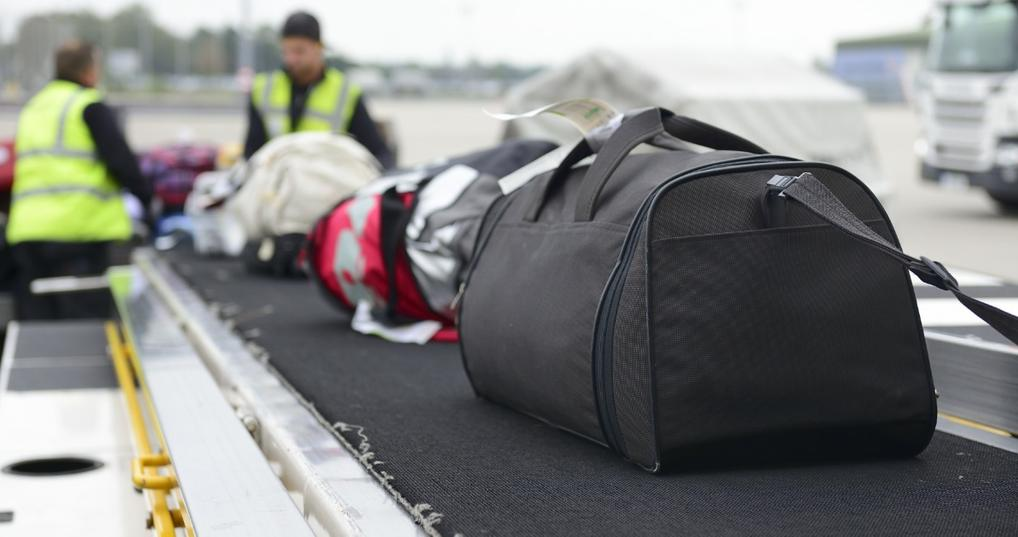 Checked baggage being loaded onto a plane