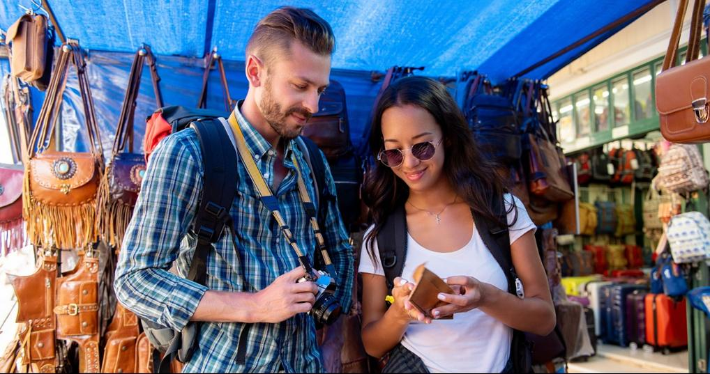 Tourist couple shopping in an outdoor market