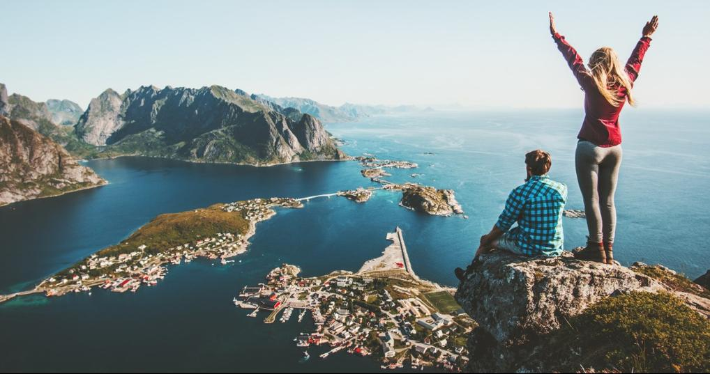 Couple overlooking the ocean from a mountaintop