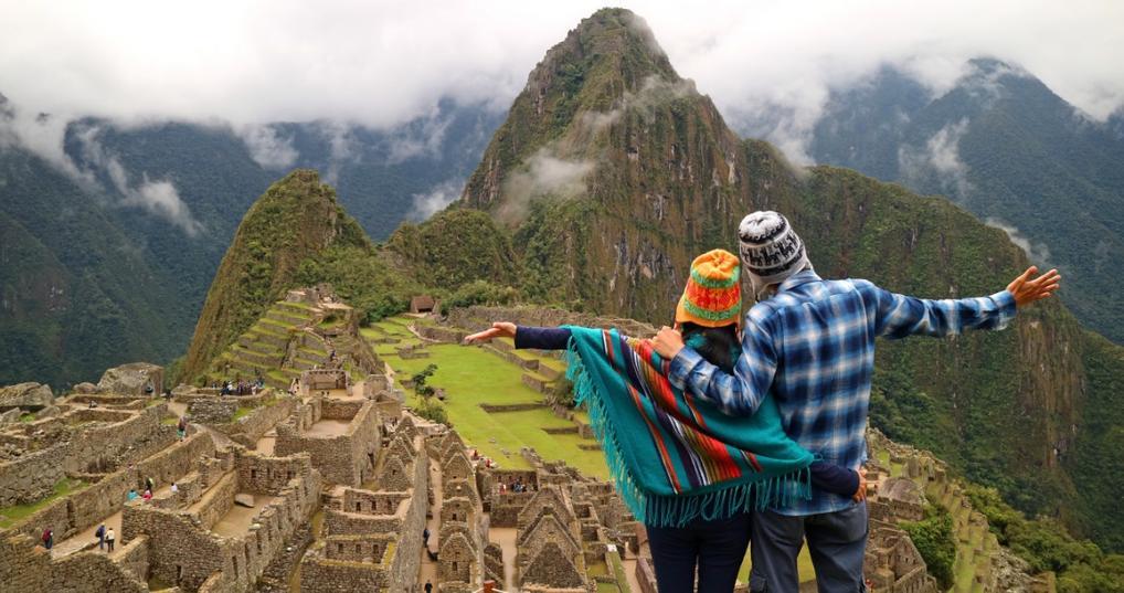 Couple overlooking Machu Picchu in Peru