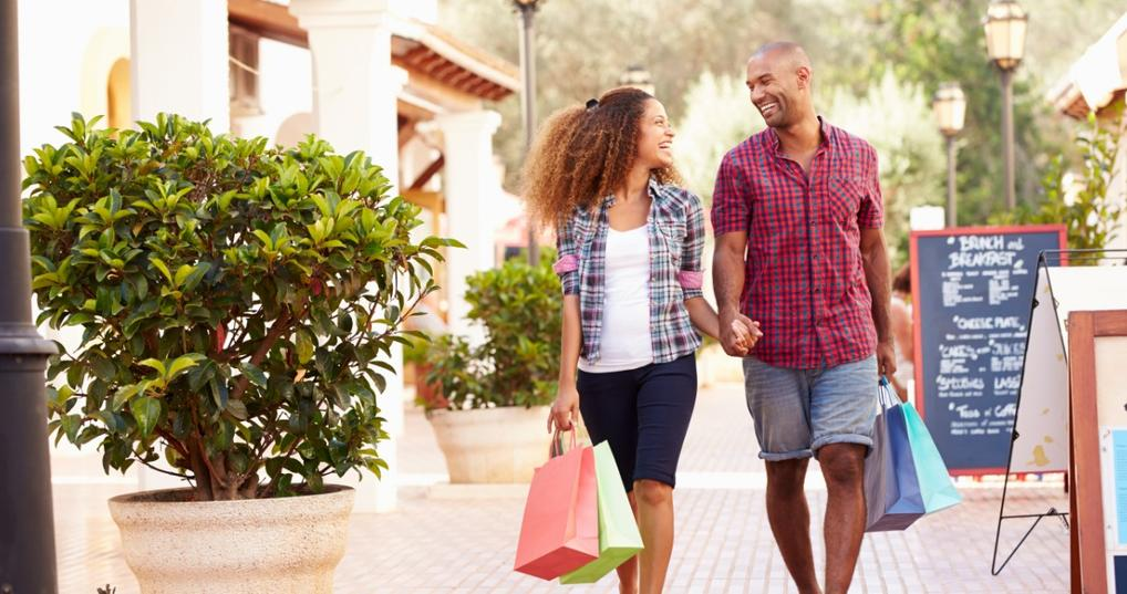 A man and woman shopping together