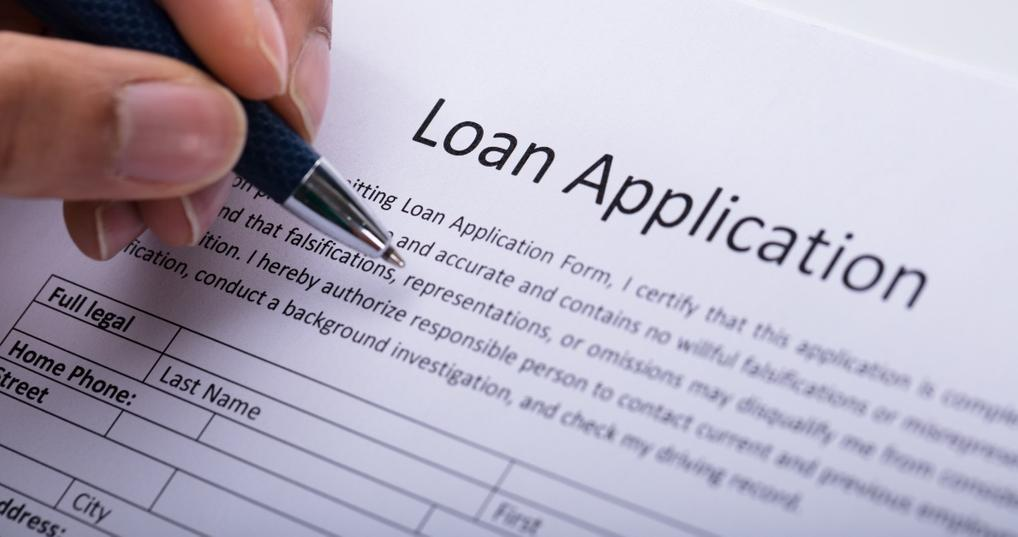 Man filling out a loan application