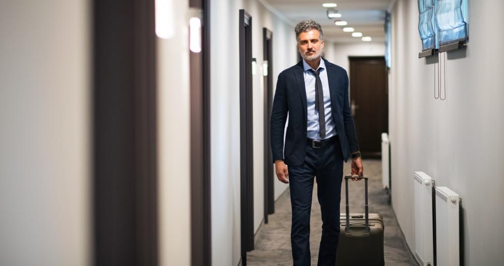 Businessman walking through a hotel hallway