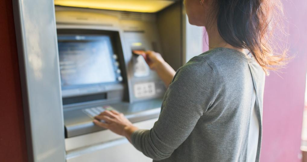 Woman Using Online Savings Account With Free ATM Access
