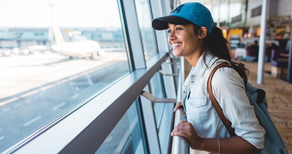 Happy young woman who has TSA PreCheck