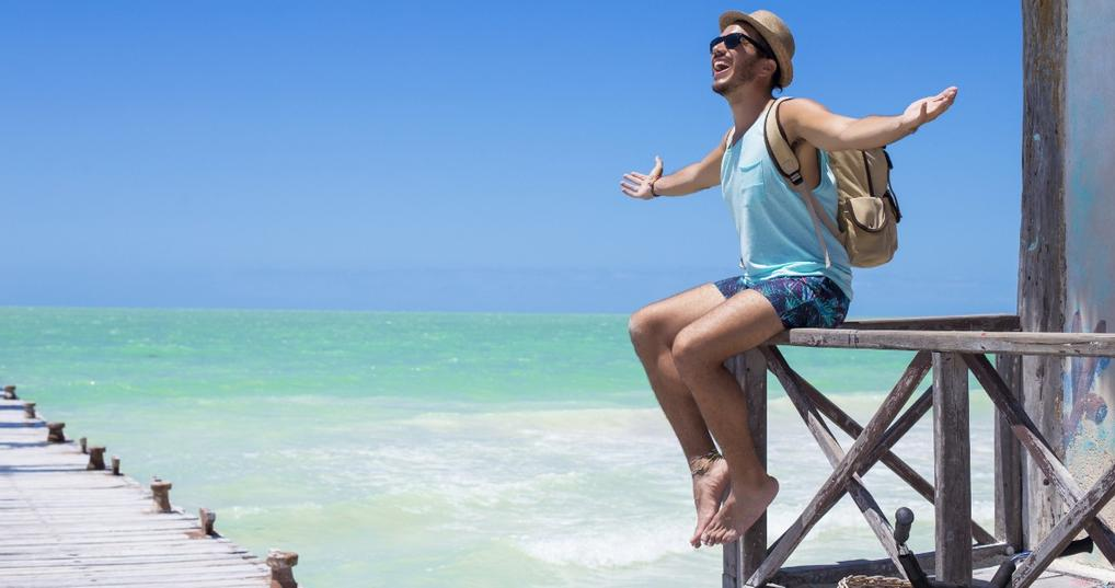 Young man happy to travel using credit card points and miles