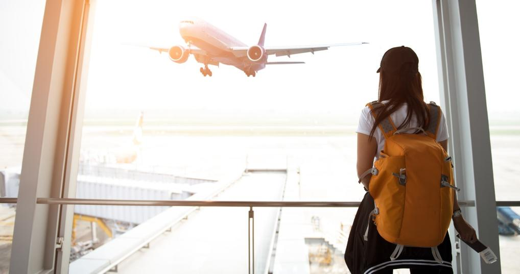 Woman Using Credit Card Points for Airline Tickets