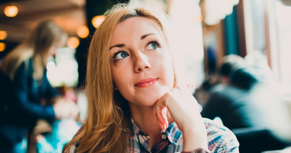 Young woman thinking about Credit Card Points Really Worth