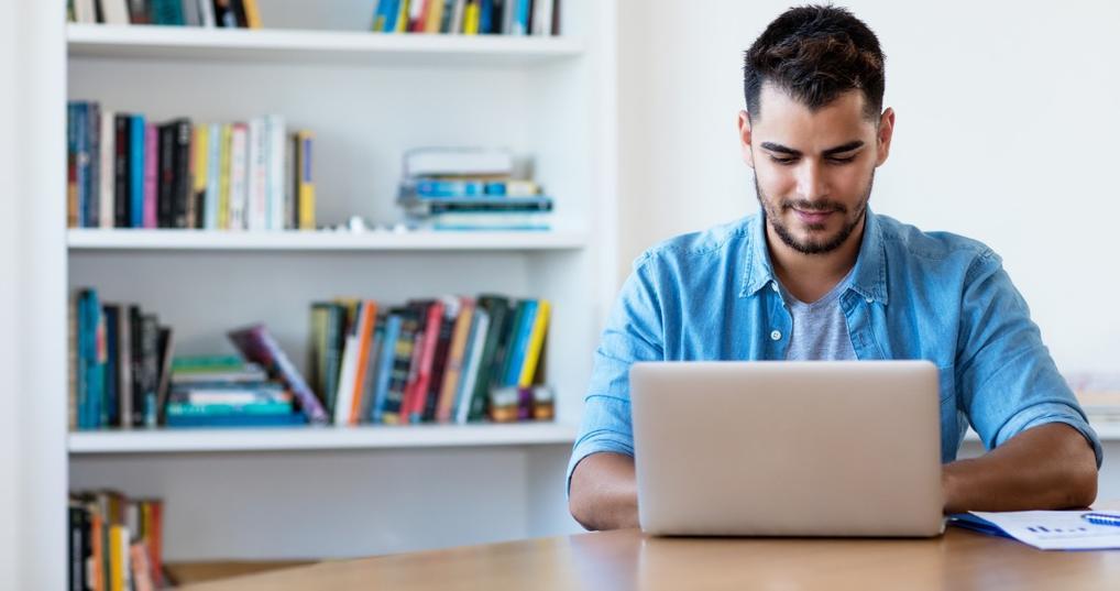Man looking at credit builder loans online