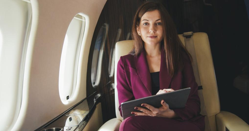 Woman flying first-class with Chase Ultimate Rewards