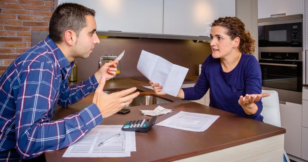 Couple arguing about credit score and debt
