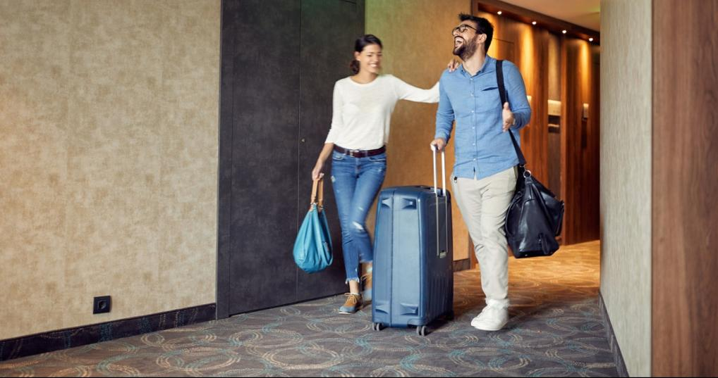 Young couple using Wyndham Rewards at a hotel