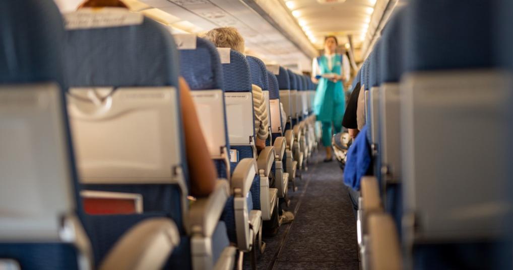 Passengers sitting in airplane seats