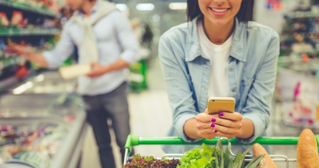 Woman shopping at grocery store with Instacart