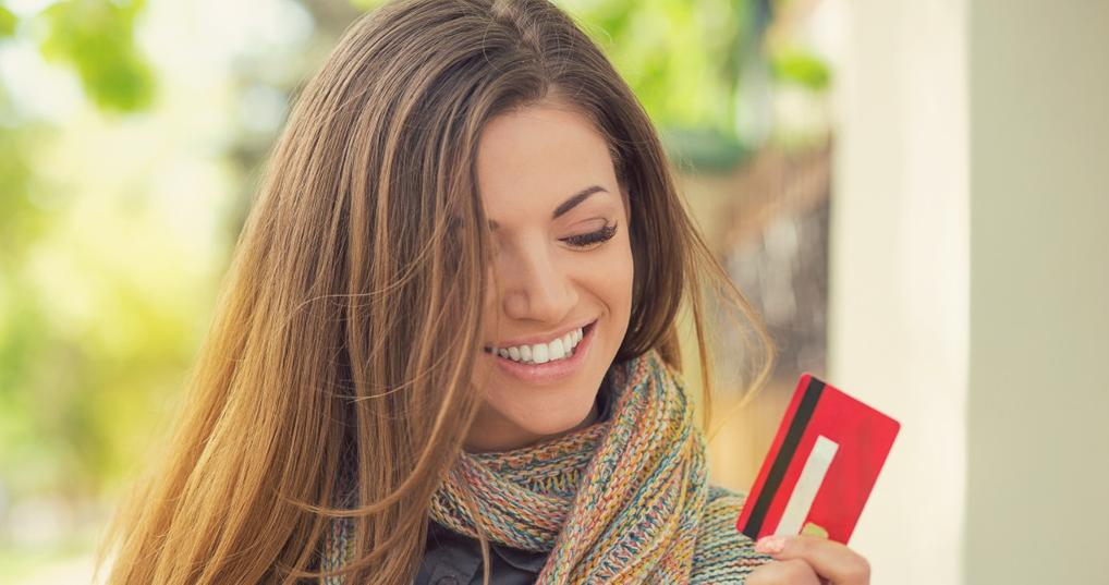 Woman with a Comenity credit card