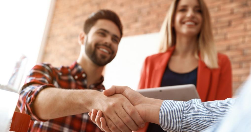 Man shaking hands with lender