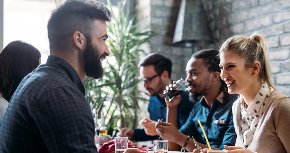 Friends dining at restaurant