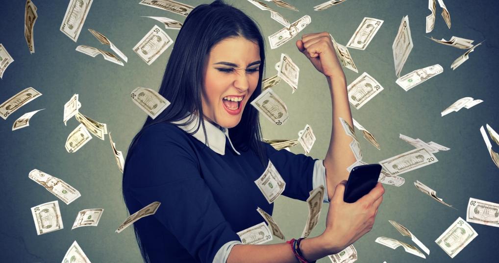Money raining on enthusiastic woman