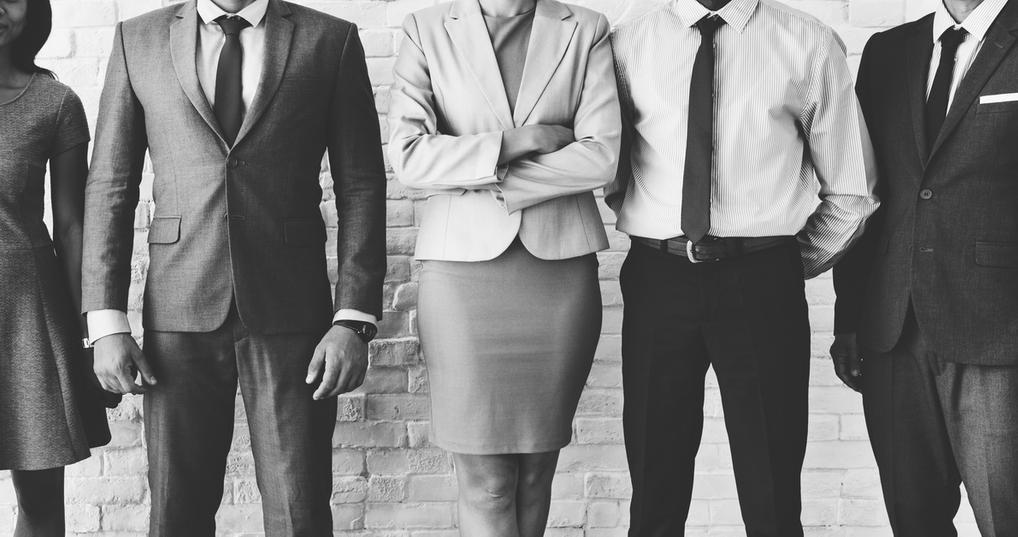 Male and female entrepreneurs standing