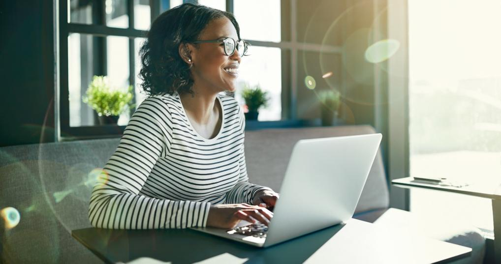 Woman comparing personal loans on her laptop