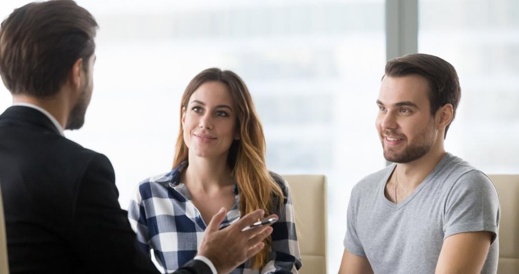 Couple talking with a lender