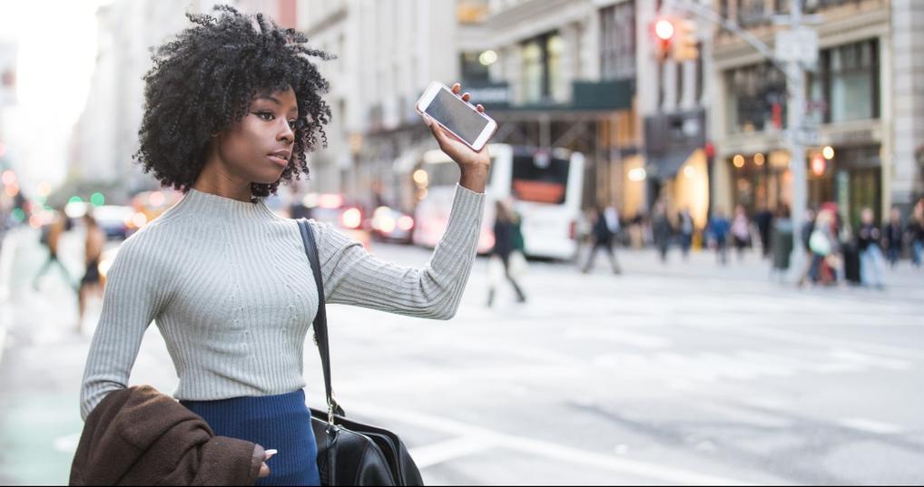 Woman hailing a Lyft driver