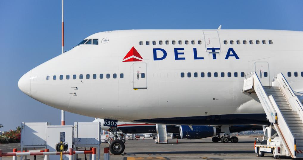 delta airplane parked on tarmac
