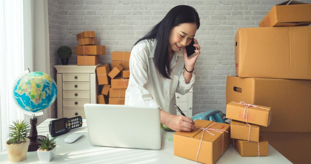 Female business owner talking on telephone