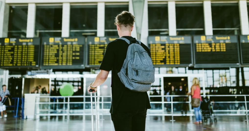Man viewing flights at the airport