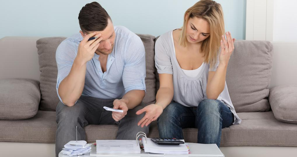 Concerned couple paying bills