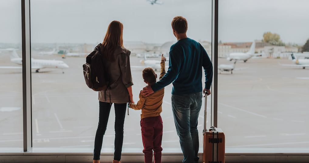 Family watching planes at airport