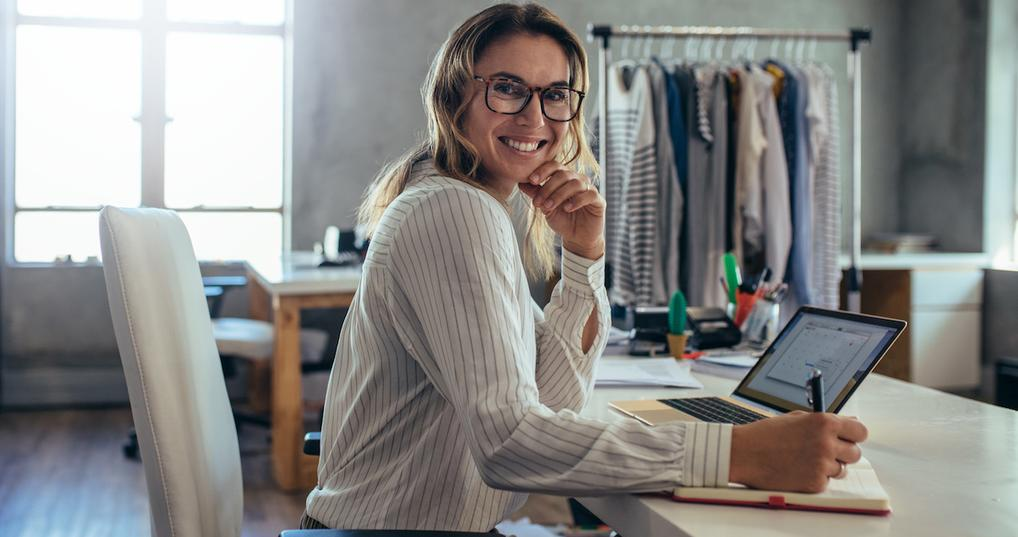 Female small business owner at desk