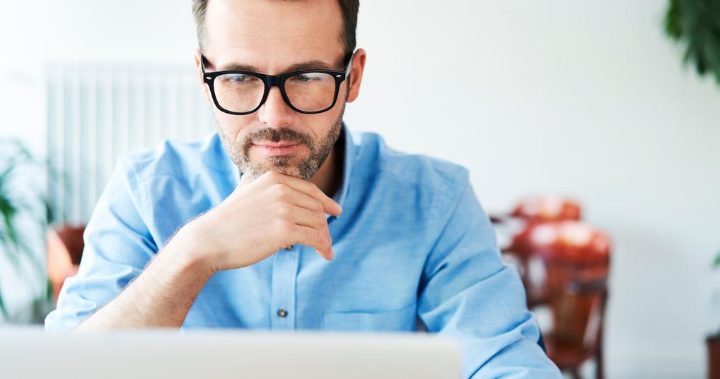 Thoughtful man at laptop