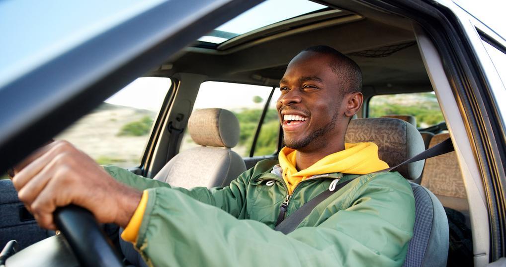 Happy man driving car