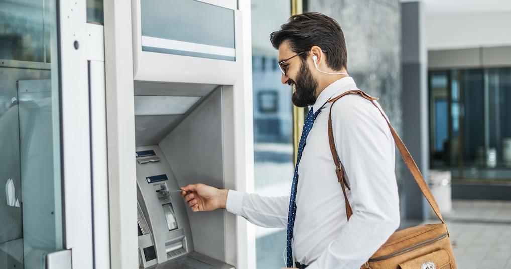 Man using ATM