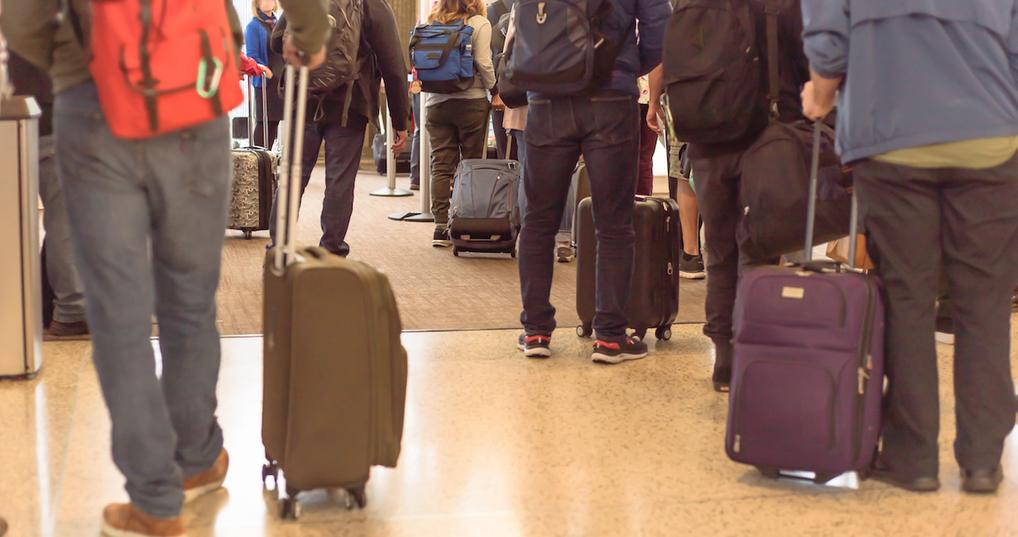 Travelers waiting in line at airport
