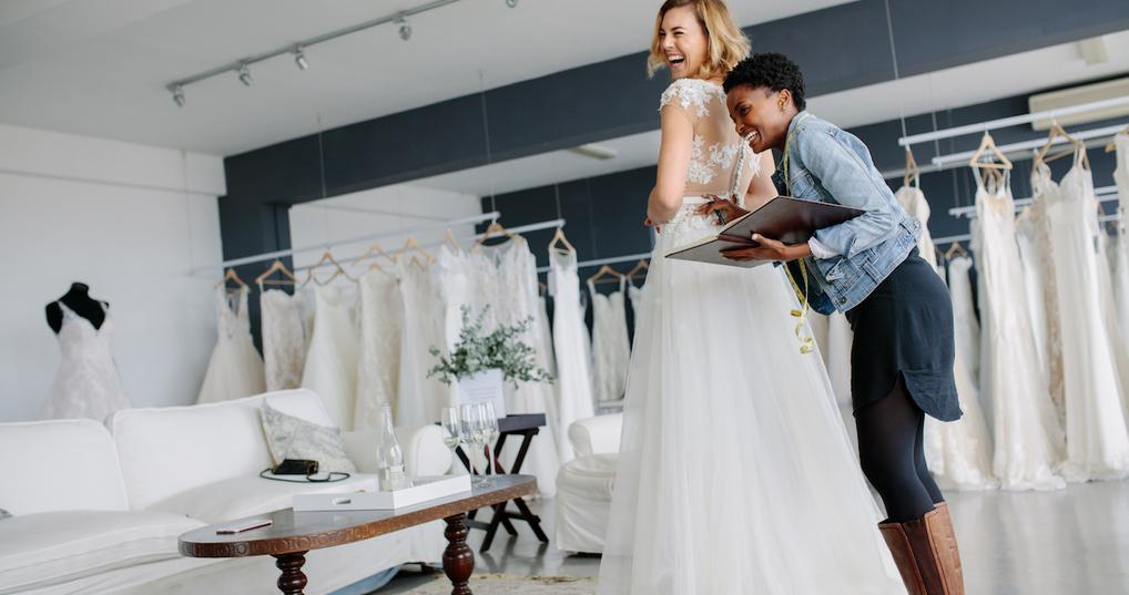 Woman trying on wedding dress in shop