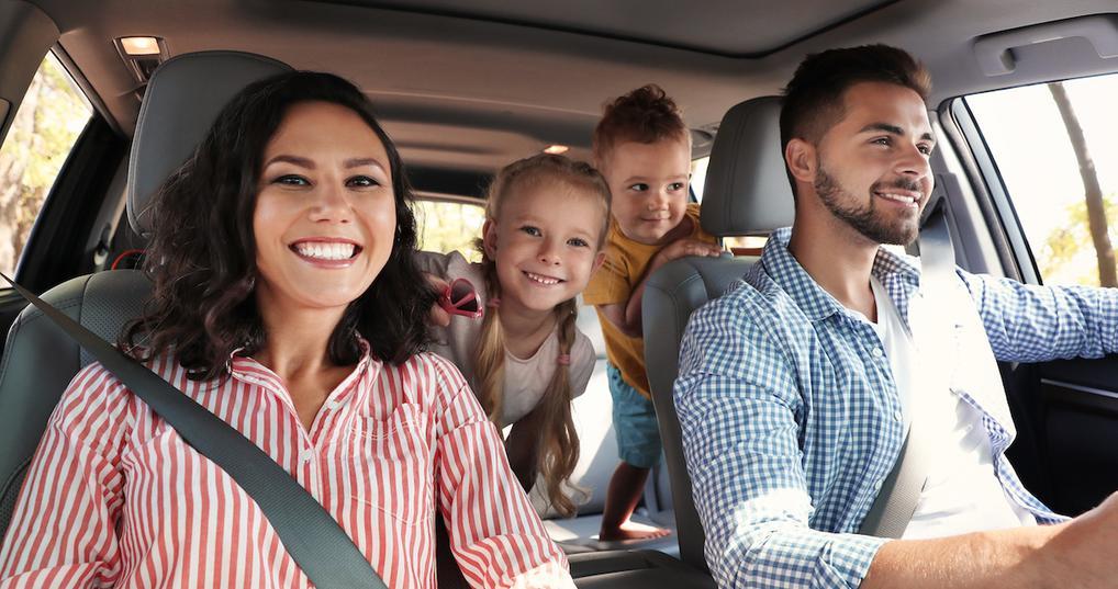 Smiling family in car