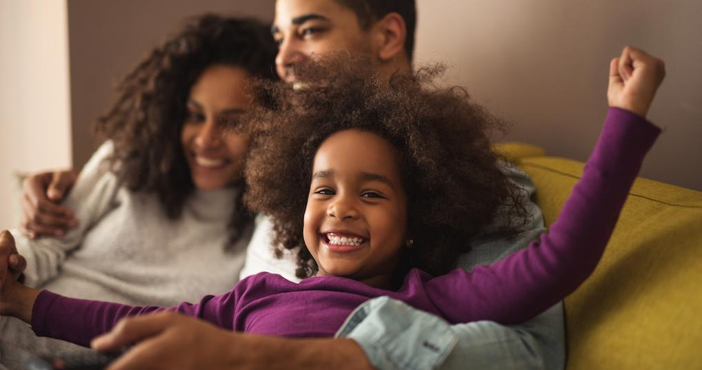 Smiling family at home